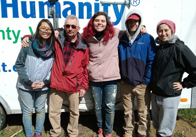 Photo of students and homeowner from a past Habitat trip|Photo of students and homeowner from a past Habitat trip
