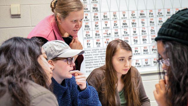 Professor assisting students