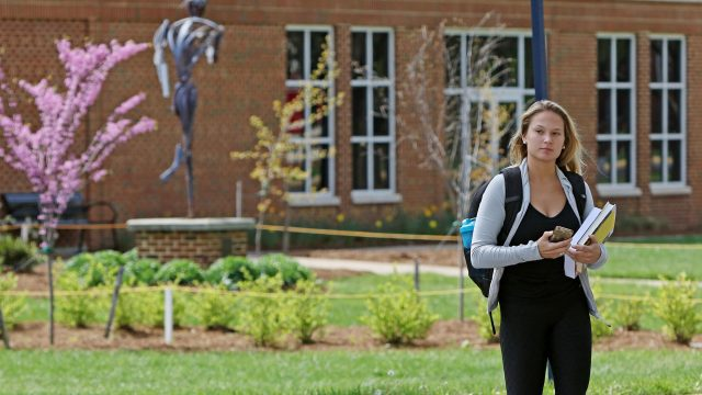 Female student walking on campus
