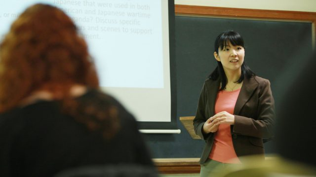 Female professor instructs class of students