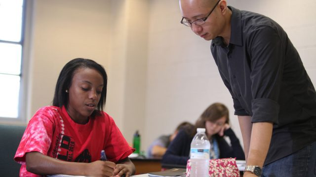 Professor assisting student