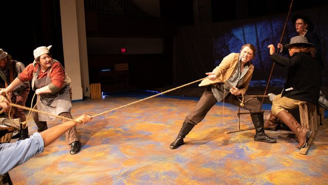 Students perform in a theatrical production