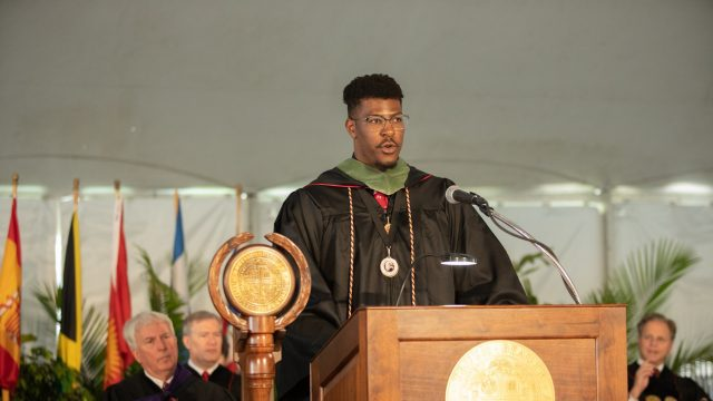 Male student delivers speech at Commencement