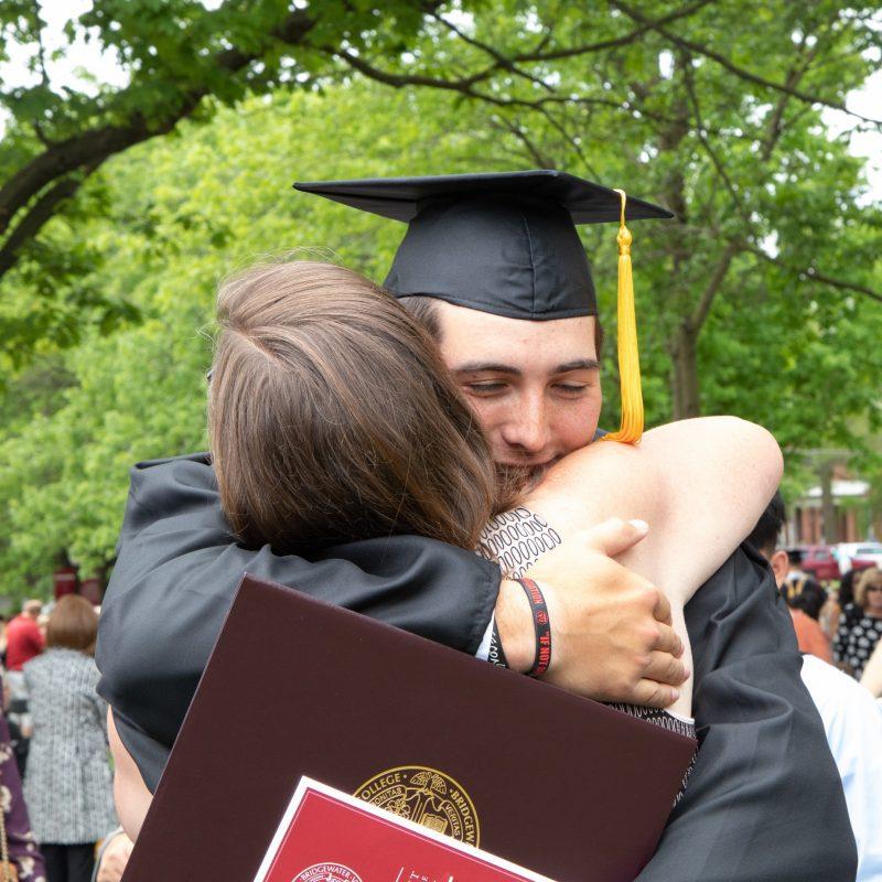 BC graduate hugs family member