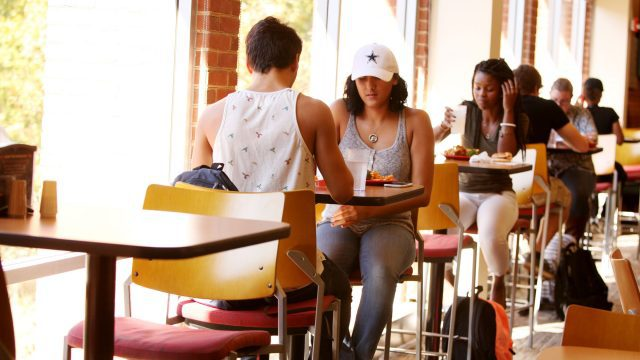 Students eating a meal inside the KCC dining hall