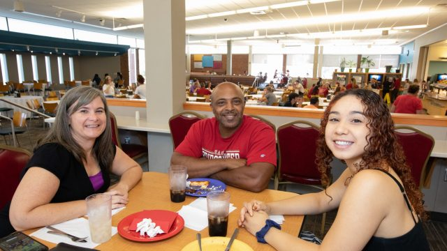Family enjoys a meal in the KCC Dining Hall