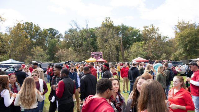 Students and fans tailgate before a football game