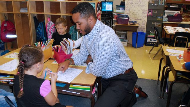 BC Students assists with elementary students.