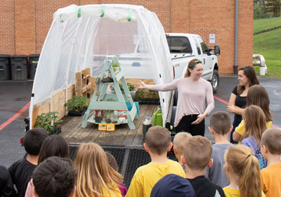 Lauren Buckhout giving a lesson to children at the greenhouse||Lauren Buckhout giving a lesson to children at the greenhouse