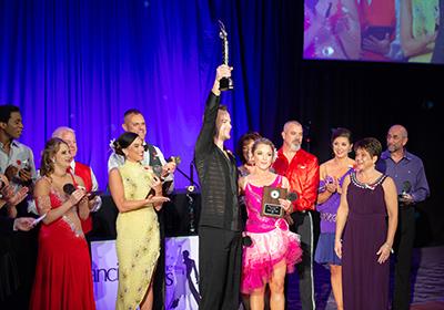 Zach Lokey holds up a trophy to celebrate his win Zach Lokey and Libbi Fitzgerald dance  Zach Lokey and Libbi Fitzgerald dance together