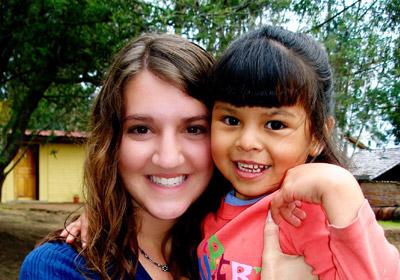 Woman holding an Ecuadorian child|