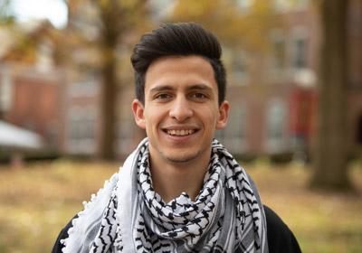 Man in black and white scarf smiles at the camera|||Photo of Haitham Alatawneh|Photo of Haitham Alatawneh||Photo of Haitham Alatawneh|