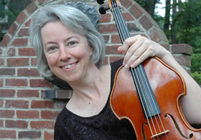 Molly Sharp of the Richmond Symphony holds her viola