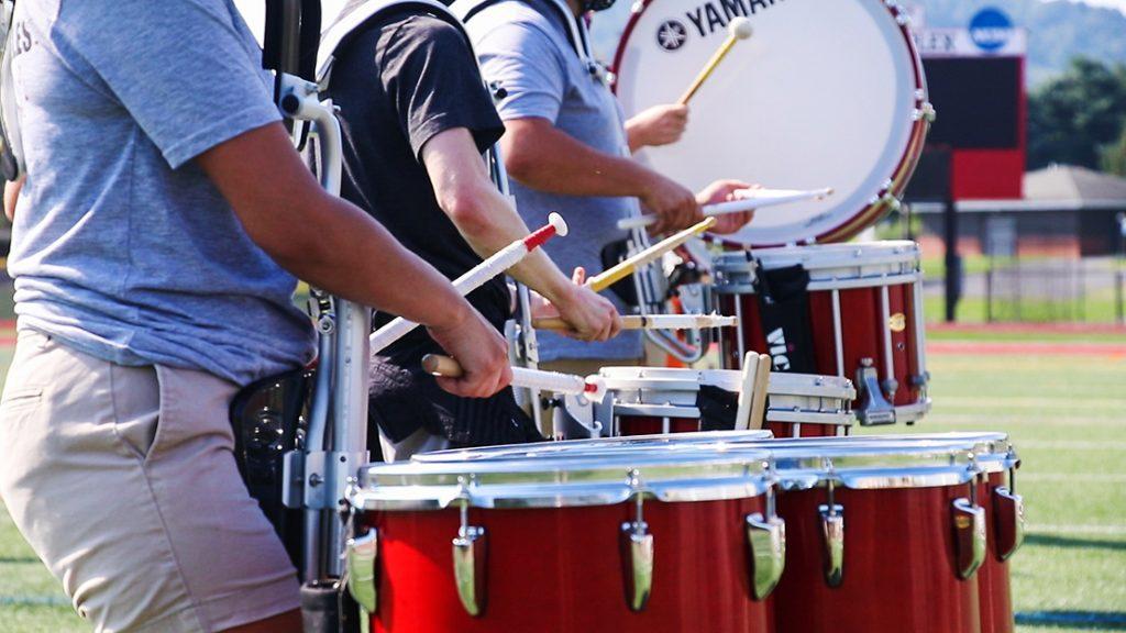 Members of a drumline play