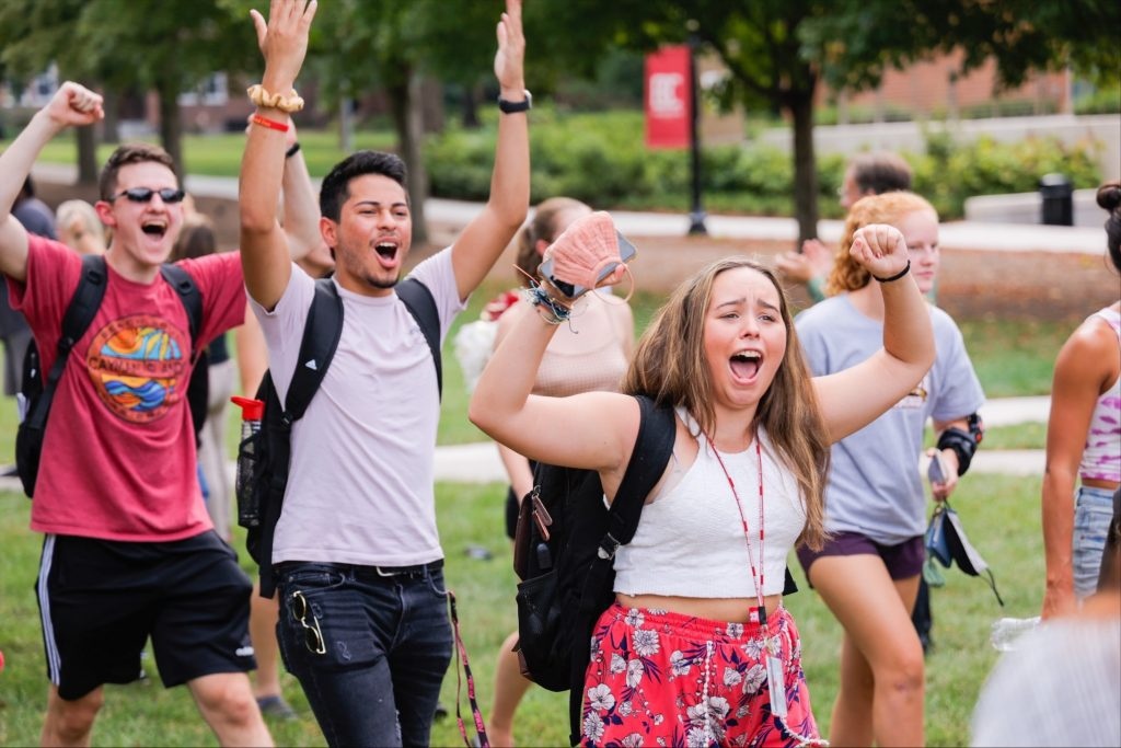 Students cheer during a welcome week activities