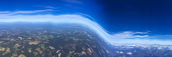 Blue and white streaks that look like an abstract airplace in the sky