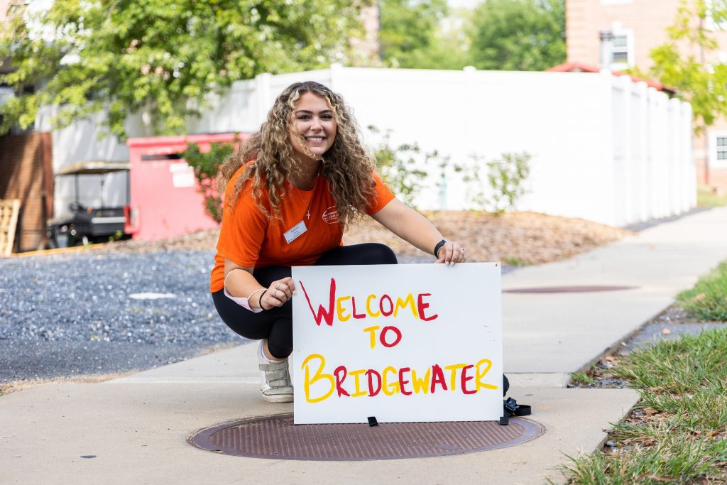 """A Bridgewater students holds a sign that says """"Welcome to Bridgewater"""""""