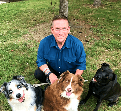 Officer Zander with his dogs Milo, Penny and Rosie